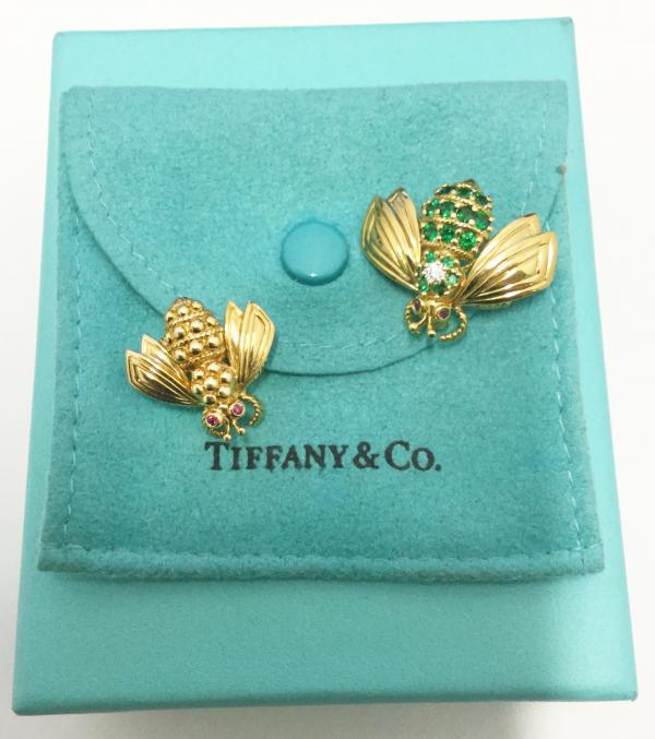 7f44d567b TWO TIFFANY 18K GOLD BUMBLE BEE PINS, ONE WITH RUBY EYES, TSAVORITE GARNET  COLOURED STONE ENCRUSTED BODY WITH A DIAMOND ACCENTED THORAX, SECOND WITH  RUBY ...